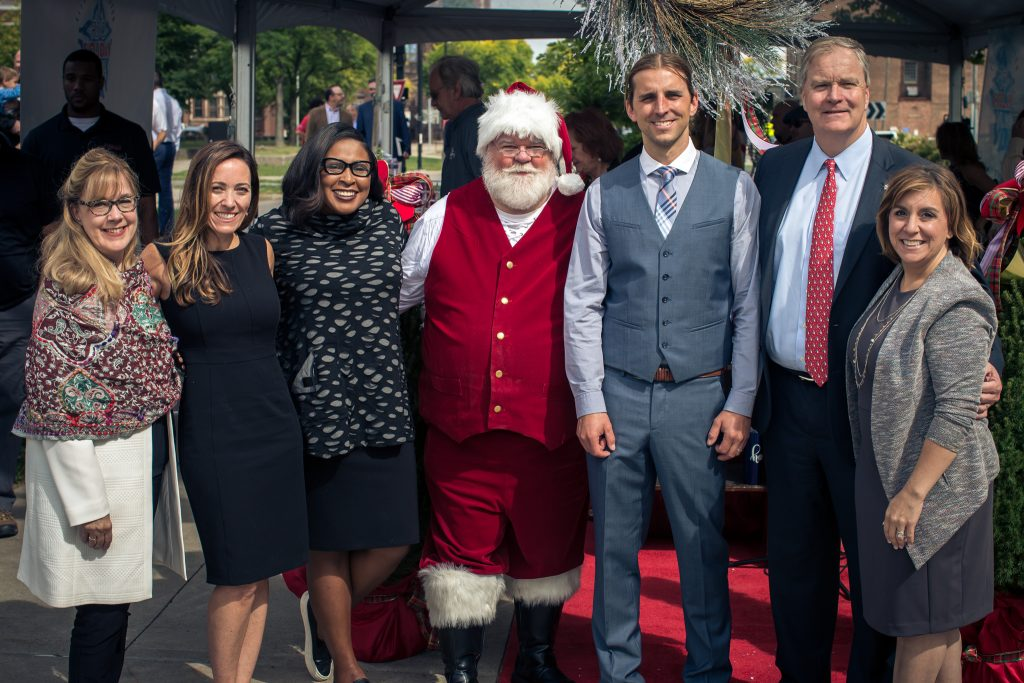 L-R: Heidi Zimmer-Meyer (RDDC, President); Kelli Marsh (co-founder); Mayor Lovely A. Warren (City of Rochester); Santa Claus; Sean McCarthy (co-founder); Marty Birmingham (Five Star Bank, President & CEO); Jenna Knauf (co-founder).